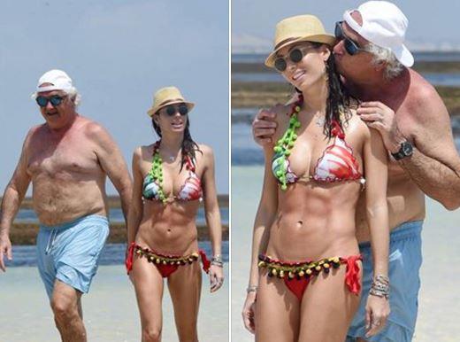 Miliardar excentric cu sotie top model. Cum a aparut la plaja sotia barbatului din imagine. El NU era de fata!