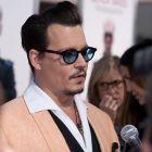 Johnny Depp nu a fost in cea mai buna forma la premiera filmului  Black Mass . Cum a aratat actorul langa sotia sa