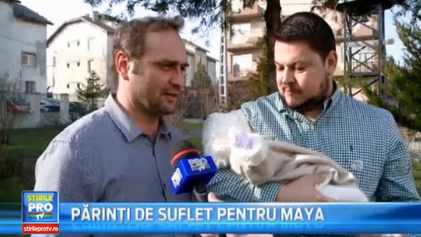 Adrian Vancica si Mihai Bobonete, nasi de botez pentru prima oara. Au crestinat-o pe fetita care s-a nascut cu pretul vietii mamei