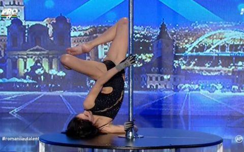 Publicul a amutit cand ea a intrat in scena. Dansul la bara desprins parca dintr-o alta dimensiune