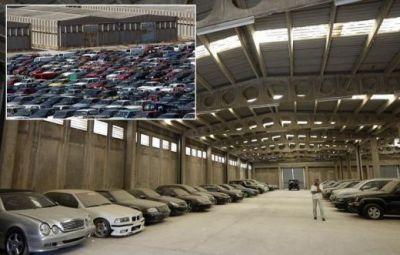 FOTO INCREDIBIL! Mii de masini ABANDONATE in depozitele din Grecia din cauza crizei! Daca le vand, grecii scapa de SARACIE! Imagini DUREROASE:
