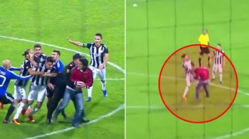 Un fotbalist roman si-a pierdut capul pe teren si s-a batut cu un suporter. Urmarile: a fost eliminat si risca sa fie dat afara | VIDEO