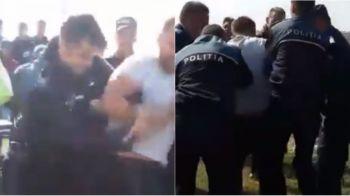 VIDEO | Imagini cu retinerea barbatului care a intrat CU SABIA pe terenul de fotbal, in liga a 5-a din Romania, si a inceput sa loveasca