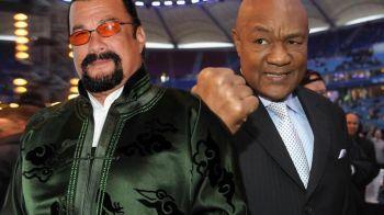 """FABULOS! Legendarul George Foreman l-a provocat pe Steven Seagal la un meci de box: """"10 runde in Vegas, ce zici?"""""""