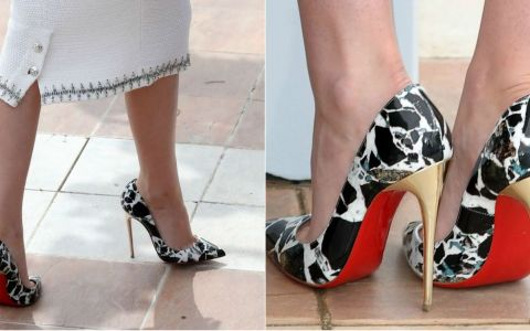Nu te-ai astepta ca tocmai ea sa poarte acesti pantofi sexy.  Baietoasa  de la Hollywood, aparitie wow la Cannes