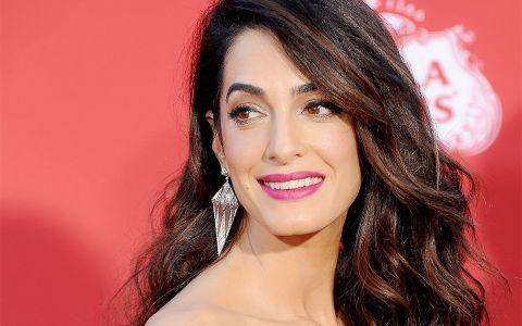 Presa mondena internationala: Amal Clooney, insarcinata a doua oara?