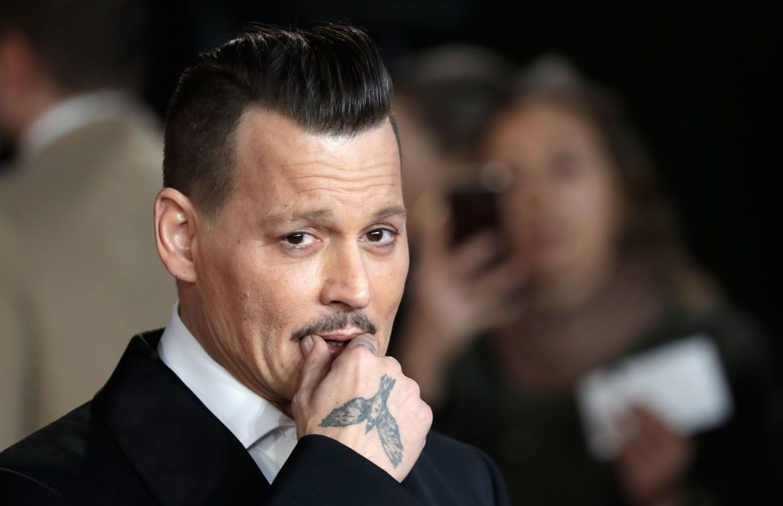 Johnny Depp a căzut la pace cu bodyguarzii care l-au dat în judecată. Ce i-au reproșat aceștia