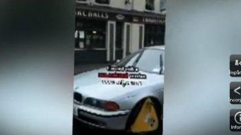 VIDEO INCREDIBIL! I-au blocat roata, dar nu l-au putut opri! Cum a protestat un sofer amendat pentru parcare neregulamentara: