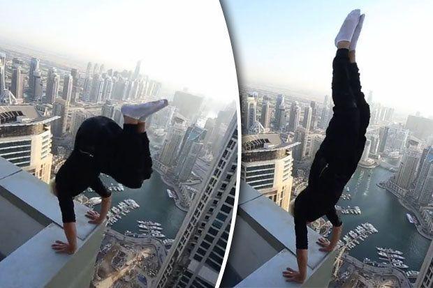 Imaginea aceasta este REALA! Cum a putut sa stea un barbat pe acoperisul unui hotel URIAS