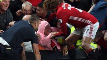 Scene nebune in Premier League! In loc sa se bucure la gol, Fellaini a salvat o femeie STRIVITA de fani in tribuna! FOTO