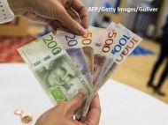 Tara din UE care renunta la banii cash. Banca centrala propune infiintarea unei monede nationale virtuale