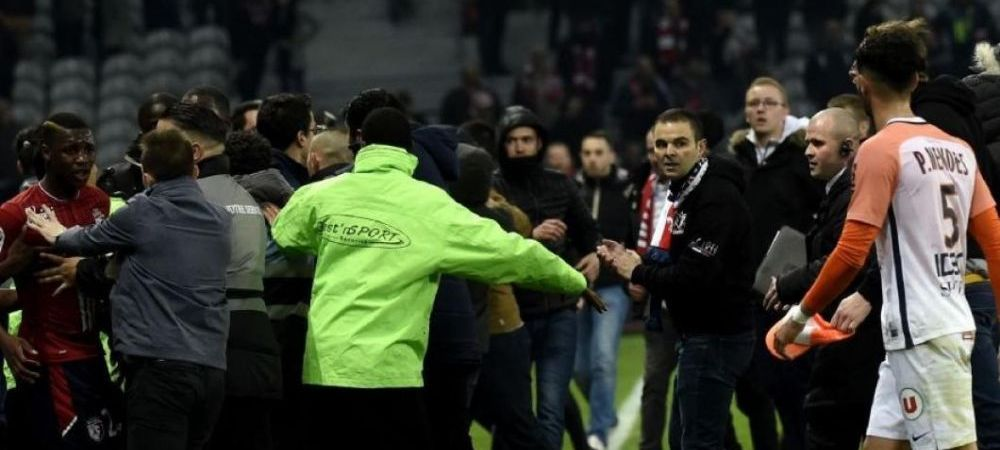 VIDEO | Scene teribile in Franta! Fanii lui Lille au intrat pe teren si si-au batut jucatorii!