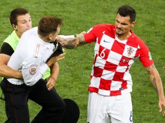 FOTO   IMAGINILE FINALEI: prima bresa de securitate a aparut chiar in finala Mondialului! Lovren a sarit la bataie: a lovit cu pumnul unul dintre fanii intrati pe teren