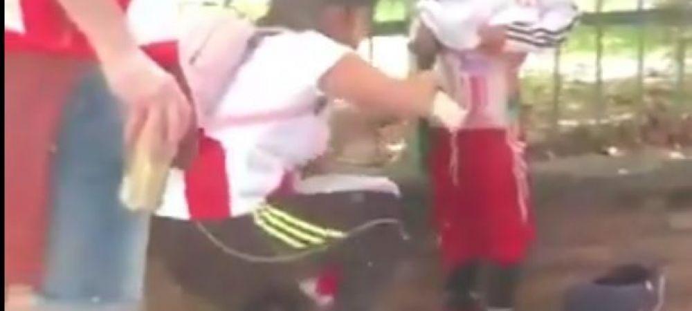 VIDEO SCANDALOS | Cum au incercat fanii sa introduca torte si fumigene in stadion inainte de River - Boca! S-au folosit de copii