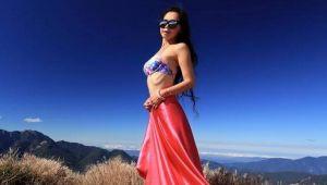 Gigi WU, modelul care se catara in bikini pe munti, a murit dupa ce a cazut intr-o rapa. FOTO