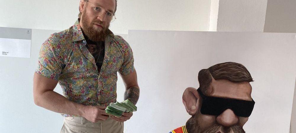 McGregor socheaza cu nou! Fotografiat cu un teanc de bani in plina criza! Cum a aparut in fata fanilor sai