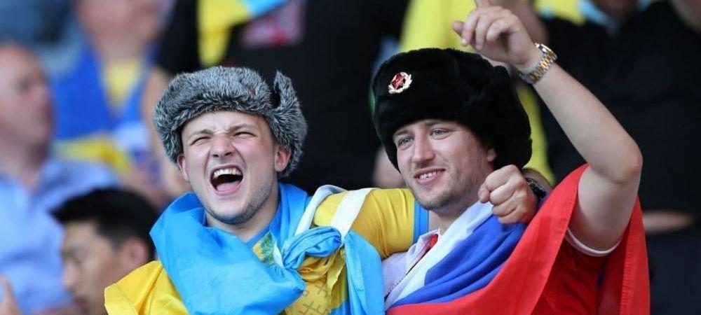 Un suporter s-a imbracat in tricoul Rusiei si s-a dus printre fanii ucraineni! E incredibil ce a putut sa urmeze dupa o repriza de zambete. Imaginile fac inconjurul lumii