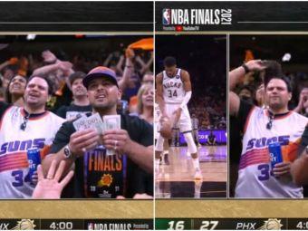 Momente ireale surprinse in direct! Faza care face inconjurul lumii: un fan s-a apucat sa isi numere banii in fata camerei, in timpul meciului din NBA