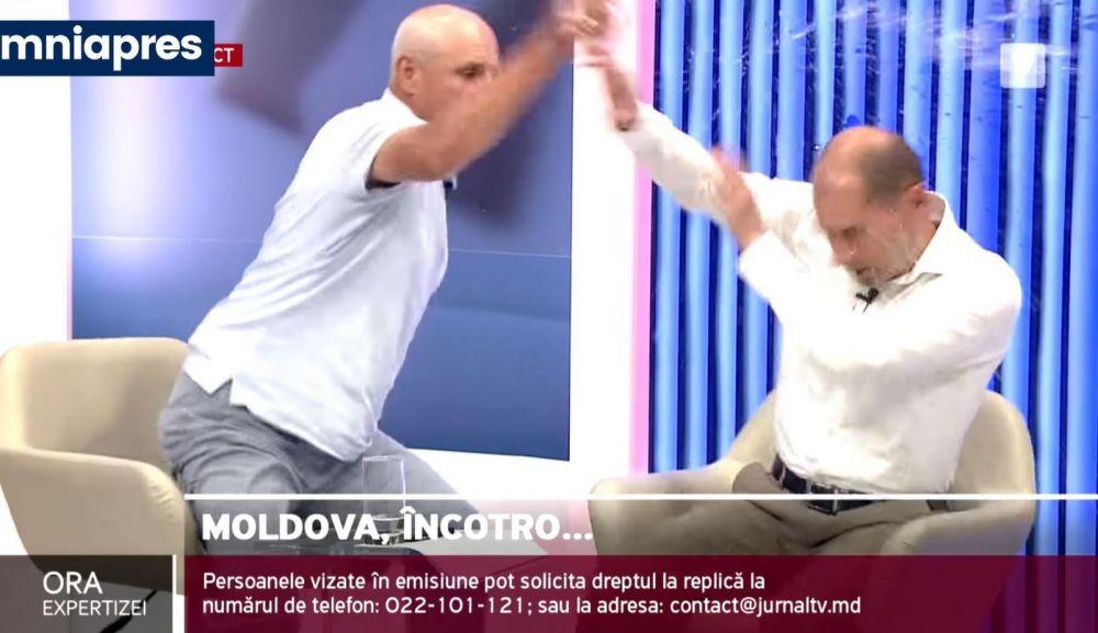 Doi politicieni s-au luat la bătaie în direct în Republica Moldova! Unul dintre ei și-a pierdut cunoștința