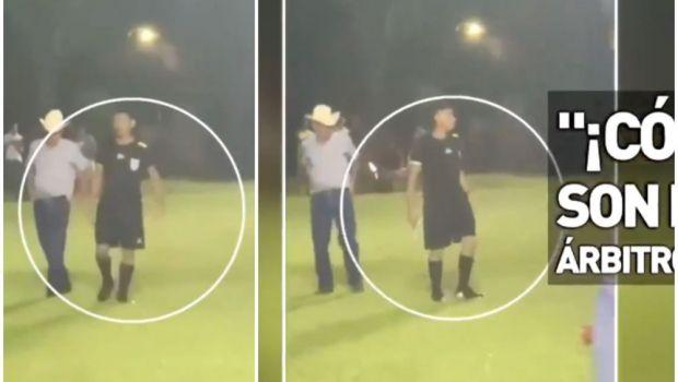 Moment uluitor la fotbal! Un arbitru a scos pistolul pe teren ca să scape de jucătorii și fanii care-i cereau socoteală