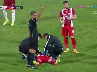 Momente de panică la Dinamo - Rapid! Răuță a căzut la pământ și a cerut rapid intervenția medicilor